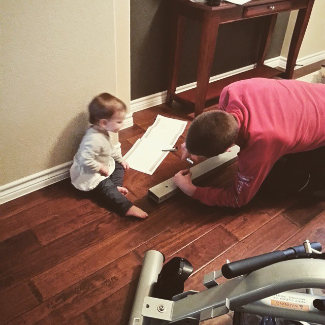 Helping Daddy Put Together Rower