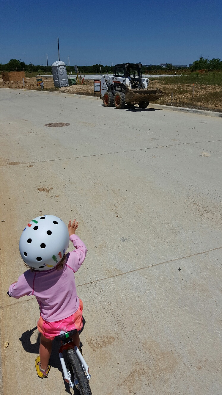 Waving to Bobcat Skidsteer loader on WOOM Balance Bike