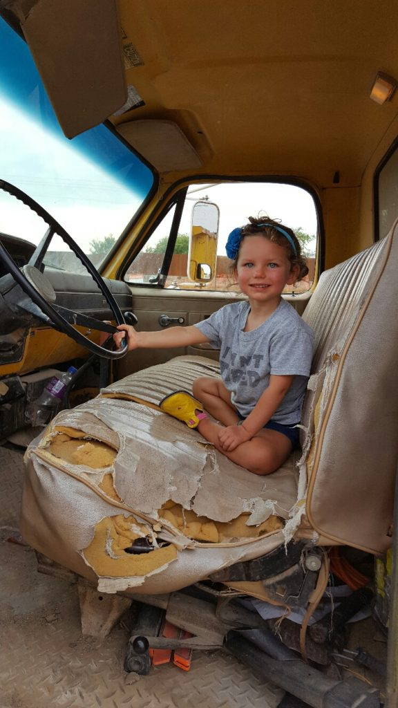Sitting in Yellow Dump Truck